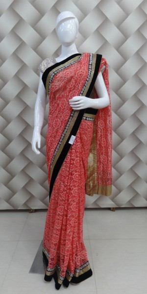 Beautiful self net orange Saree